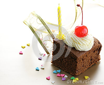 Chocolate birthday cake with cherries and  cream