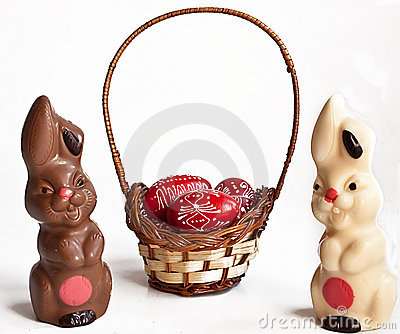 Chocolate bunnies and egg in basket