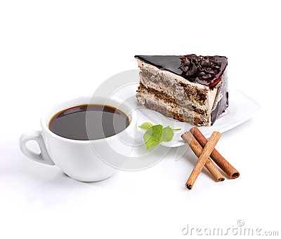 Chocolate cake, coffee and green leafage