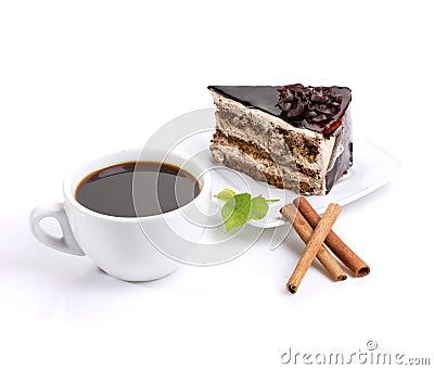 Chocolate cake, coffee and green leafage