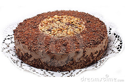 Sweet chocolate cake with chocolate glaze and nuts.