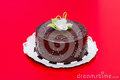 Chocolate cake with white candy rose decoration