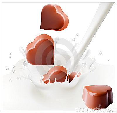 Chocolate candies falling into the milky splash.