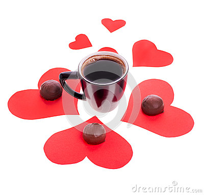 Chocolate candy at the heart of paper and coffee black