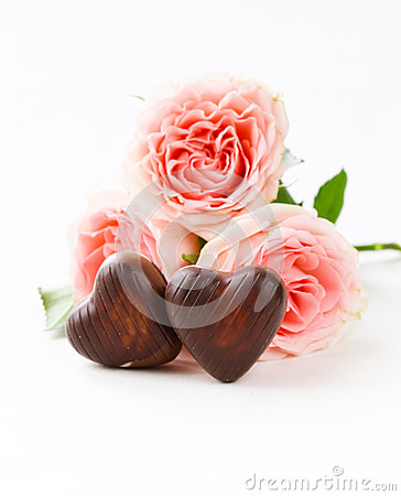 Free Chocolate Candy In The Shape Of Hearts And Pink Roses For Valentine S Day Stock Photos - 47037413