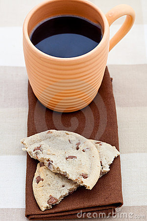 Chocolate chip cookie on a brown napkin