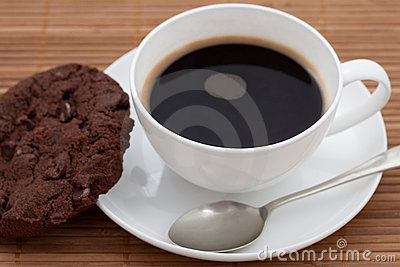 Chocolate chip cookie with a cup of black coffee