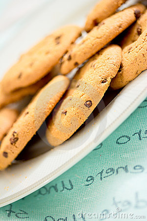Chocolate chip cookies on blue table set