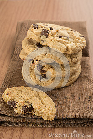 Chocolate chip cookies on brown kitchen towel
