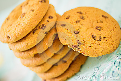 Chocolate chip cookies stacked on blue table set