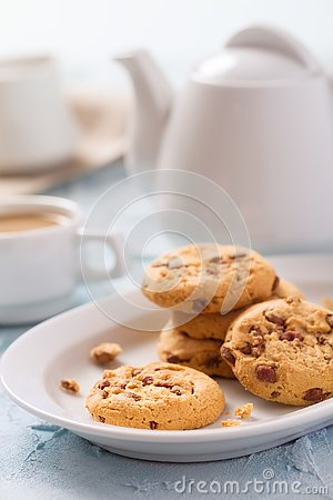 Chocolate chips cookies with cup of coffee with milk on pastel blue background Stock Photo