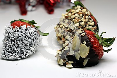 Chocolate coated strawberry with almonds and coconuts