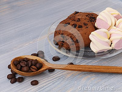 Chocolate cookies sticks with marshmallows on blue background Stock Photo