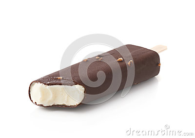 Bitten chocolate covered vanilla ice cream bar with nuts on a wooden ...