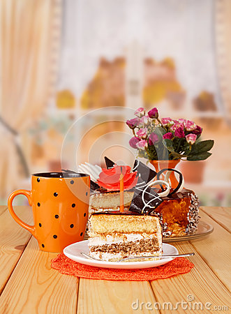 Free Chocolate Cream Cake, Cup Tea, Slice, Candle On Background Kitchen. Stock Photo - 80307980