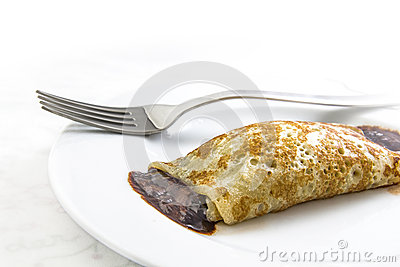Chocolate crepe on dish