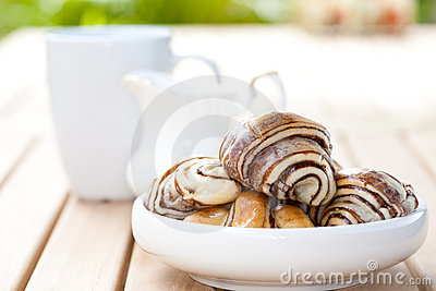 Chocolate croissant in an outdoor setting.