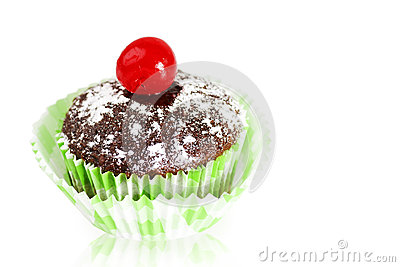 Chocolate cupcake with cherry on white
