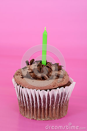 Chocolate cupcake focus on candle