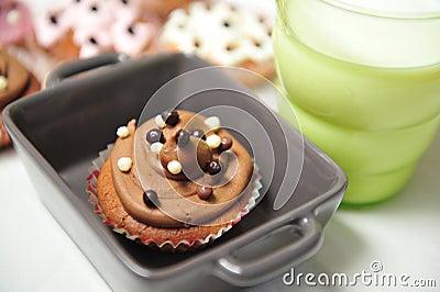 Chocolate cupcake and milk