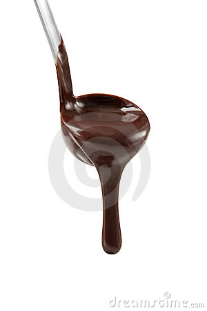 Chocolate dripping from ladle
