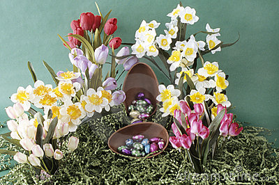 Chocolate easter egg halved with flowers and eggs