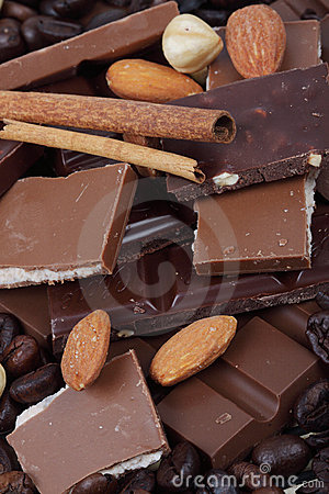 Chocolate, hazelnuts and coffee beans Stock Photo