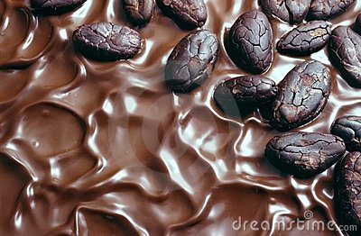 Chocolate icing and cocoa beans