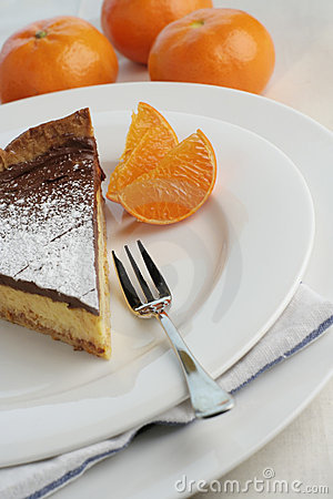 Free Chocolate Mocha And Orange Cheesecake With Dessert Fork Stock Images - 1213444