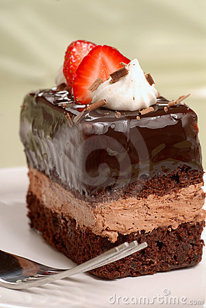Chocolate mousse cake with cut strawberries