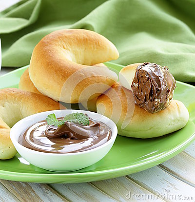 Chocolate nut paste (nutella) for breakfast with bread rolls.
