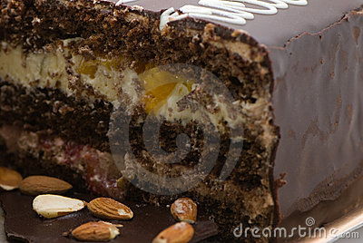Chocolate pie with almonds and a cream stuffing in