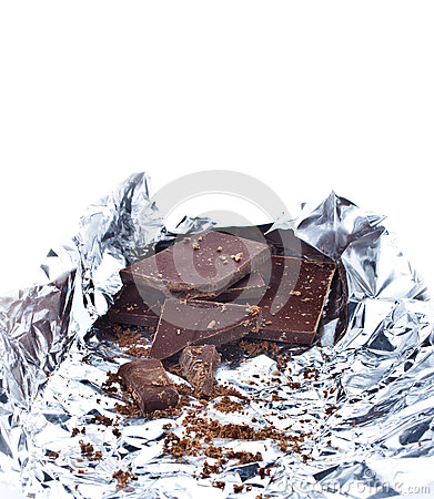 Chocolate pieces crumpled in foil on white background