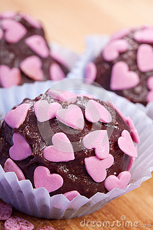 Free Chocolate Pralines With Pink Hearts Royalty Free Stock Photo - 25755455