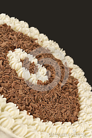 Chocolate shavings and cream on a brown background