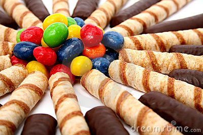 Chocolate sticks with a cream and the multi-coloured sweets