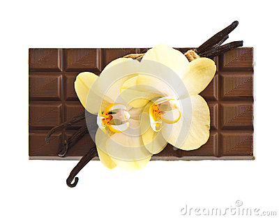 Chocolate with vanilla pods and orchid flowers