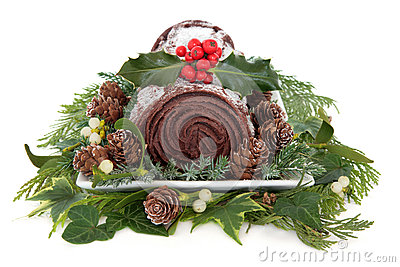 Christmas chocolate yule log cake with holly, mistletoe and winter ...