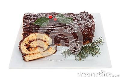 Chocolate yule log on a plate