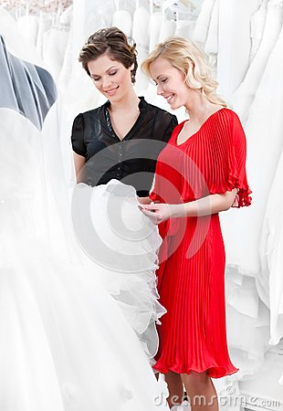 Choosing wedding dress at the bridal salon