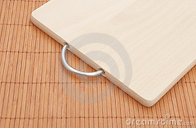 Chopping board on bamboo placemat