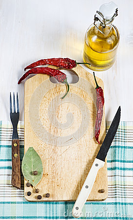 Chopping board, pepper, fork and knife