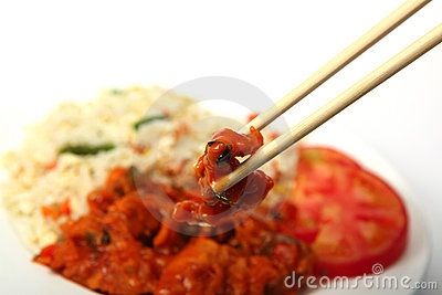 Chopsticks with chicken sweet and sour