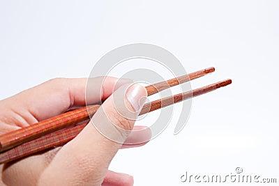 Chopsticks are the hand grip.