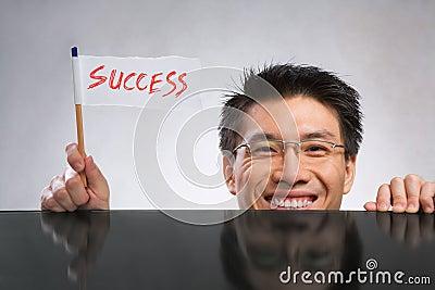 Chorągwiany mienia mężczyzna sukces
