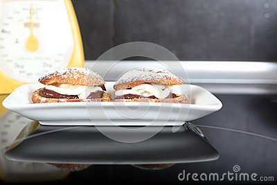 Choux pastry with vanilla and chocolate cream