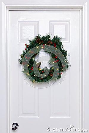 Chrismas wreath on a white door