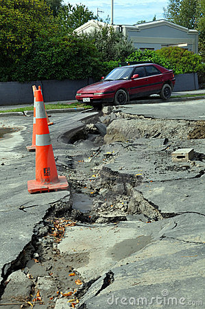 Free Christchurch Earthquake - Car Falls Into Crack Royalty Free Stock Photos - 18490408