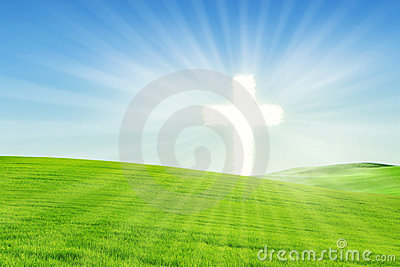 Christian background: Glowing Cross on the field