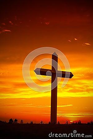 Christian cross silhouette during sunset